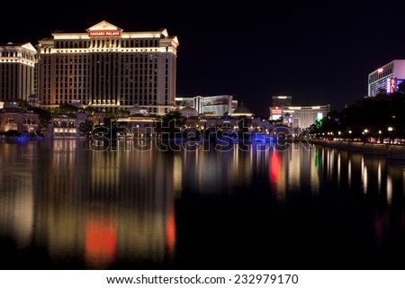 Las Vegas, Nevada, USA - Sept. 25, 2014: Buildings at the Caesars Palace casino and hotel reflecting in the fountain lake a night along the Las Vegas Blvd in Las Vegas, Nevada, USA on Sept. 25, 2014 - stock photo