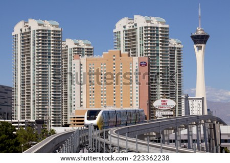 Las Vegas, Nevada, USA - September 22, 2014:  Electric monorail train with the Stratosphere casino tower in the background in Las Vegas, Nevada, USA on September 22, 2014 - stock photo