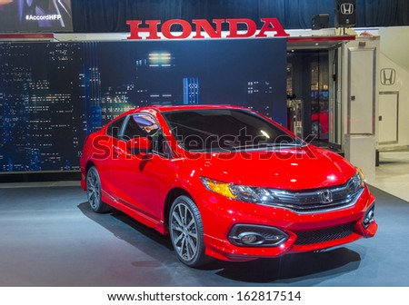 LAS VEGAS - NOV 05 : Red Honda car on Honda booth at the SEMA Show in Las Vegas, Navada, on November 05, 2013. The SEMA Show is the premier automotive specialty products trade event in the world.