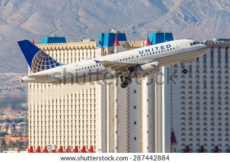 LAS VEGAS - NOVEMBER 3: Airbus A320 United Airlines takes off from McCarran Airport in Las Vegas, NV on November 3, 2014. A320 was the first narrow body airliner from Airbus. - stock photo