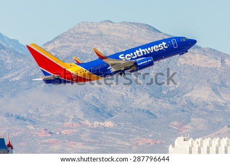 LAS VEGAS - NOVEMBER 3: Boeing 737 Southwest Airlines takes off from McCarran in Las Vegas, NV on November 3, 2014. Southwest is a major US airline and the world's largest low-cost carrier. - stock photo