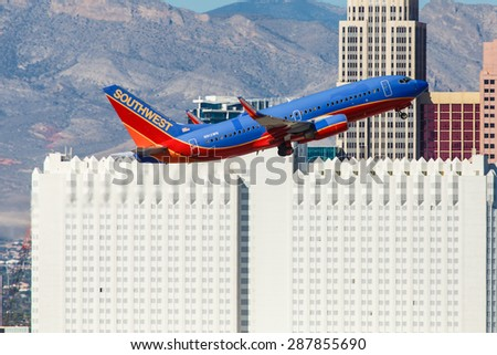 LAS VEGAS - NOVEMBER 3: Boeing 737 Southwest Airlines takes off from McCarran in Las Vegas, NV, USA on November 3, 2014. Southwest is a major US airline and the world's largest low-cost carrier. - stock photo