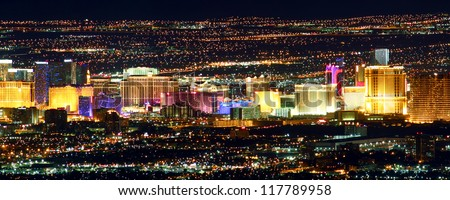 LAS VEGAS - NOVEMBER 26: Famous Las Vegas Strip on November 26, 2011 in Las Vegas. The Strip is about 4 miles long and is seen here from the Frenchman Mountain summit. - stock photo