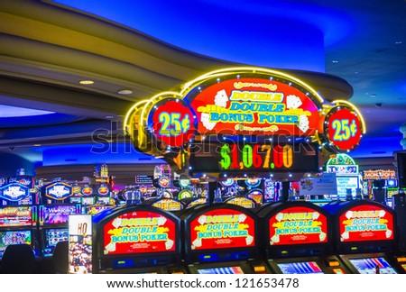 LAS VEGAS - NOVEMBER 08: Interior casino and slot machines on November 08, 2012 in Las Vegas. Las Vegas in 2012 is projected to break the all-time visitor volume record of 39-plus million visitors - stock photo