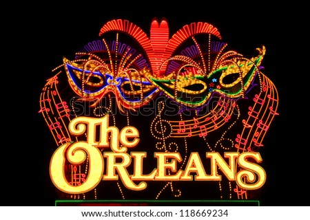 LAS VEGAS - NOVEMBER 30: The Orleans Hotel and Casino Sign on November 30, 2011 in Las Vegas.  The Orleans has a Mardi Gras theme and was opened in the year 1996. - stock photo