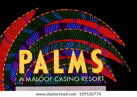 LAS VEGAS - NOVEMBER 30: The Palms Resort Casino Sign on November 30, 2011 in Las Vegas.  The Palms is a modern styled hotel and casino that opened in 2001 on Flamingo Road. - stock photo