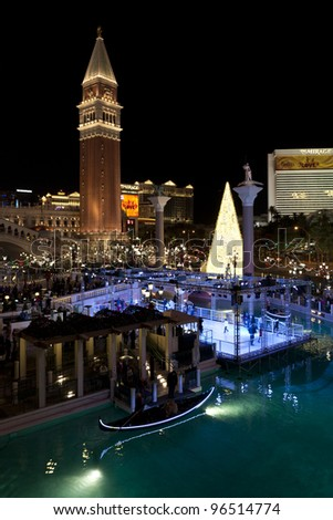 LAS VEGAS - NOVEMBER 22: Venetian Hotel Casino on November 22, 2011 in Las Vegas, Nevada.  At Christmas season Venetian is famous  with spectacular nightly light show and ice skating rink. - stock photo
