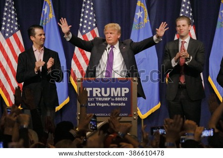 LAS VEGAS, NV - FEBRUARY 23, 2016: Donald Trump is flanked by sons Eric (Right) and Donald Jr. (Left) during Mr. Trump's victory speech after Nevada caucus, Las Vegas, NV at Treasure Island Casino and Hotel - stock photo