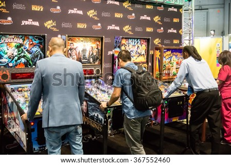Las Vegas, NV - Jan. 8, 2016: Visitors to the 2016 Consumer Electronics Show (CES) test their skills on a new generation of electronic pinball games in Las Vegas.