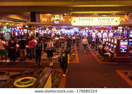 LAS VEGAS, NV- JULY 13, 2013: Crowded Casino area inside Excalibur Hotel and Casino. - stock photo