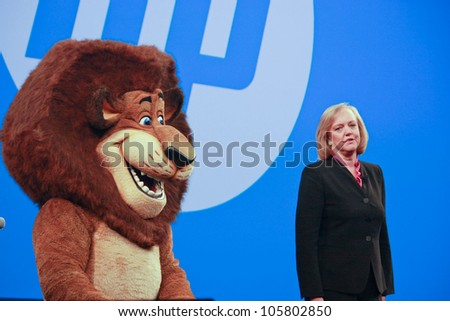 LAS VEGAS, NV - JUNE 5, 2012: HP president and chief executive officer Meg Whitman delivers an address to HP Discover 2012 conference with cartoon character lion on June 5, 2012 in Las Vegas, NV - stock photo