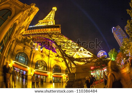 LAS VEGAS, NV - JUNE 15: Paris Las Vegas hotel and casino on June 15, 2012 in Las Vegas, Nevada, USA. It includes a half scale, 541-foot (165 m) tall replica of the Eiffel Tower - stock photo