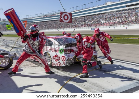 Las Vegas, NV - Mar 08, 2015:  Kyle Larson (42) brings his race car in for service during the Kobalt 400 race at the Las Vegas Motor Speedway in Las Vegas, NV. - stock photo