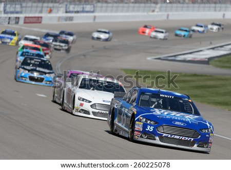 LAS VEGAS, NV - March 08: Cole Whitt (35) leading a pack of cars a the NASCAR Sprint Kobalt 400 race at Las Vegas Motor Speedway on March 08, 2015 - stock photo
