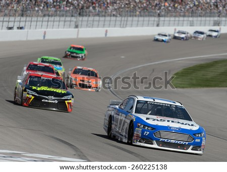 LAS VEGAS, NV - March 08: Ricky Stenhouse Jr leading a pack of cars at the NASCAR Sprint Kobalt 400 race at Las Vegas Motor Speedway on March 08, 2015 - stock photo