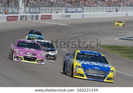 LAS VEGAS, NV - March 08: Sam Hornish Jr (9) leading a pack of cars at the NASCAR Sprint Kobalt 400 race at Las Vegas Motor Speedway on March 08, 2015 - stock photo