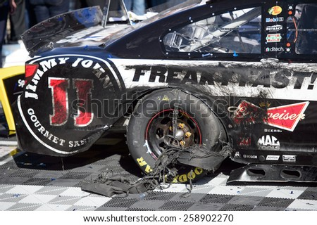 LAS VEGAS, NV - March 08:Torn up tire at Kevin Harvick's winning car of the  NASCAR Sprint Kobalt 400 race at Las Vegas Motor Speedway on March 08, 2015 - stock photo