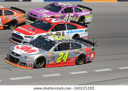 LAS VEGAS, NV - March 08: 3 wide in turn 4, Jeff Gordon 24, Ryan Blaney 21 and Michael Annett 46 at the NASCAR Sprint Kobalt 400 race at Las Vegas Motor Speedway on March 08, 2015