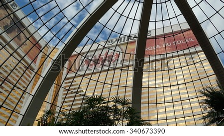"""LAS VEGAS, NV - OCT 29: Mirage Hotel and Casino on the Strip in Las Vegas, Nevada, on Oct 29, 2015. The property includes an artificial volcano that """"erupts"""" nightly from 8 pm to midnight on the hour. - stock photo"""