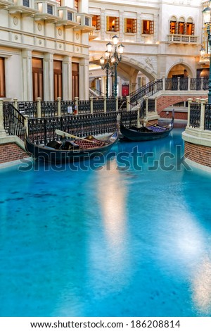 Las Vegas, NV, USA - April 7th, 2013: Indoor view of the canals inside the Venetian Casino. Canal blue water in the foreground with Buildings gondola and bridges in the background. No people.