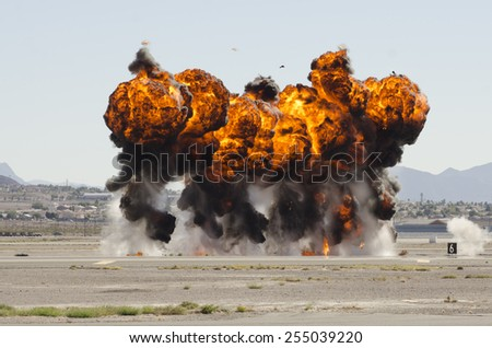 Las Vegas, NV, USA -November 09, 2014: Explosions as part of a demonstration at Nellis Air Force Base, Aviation Nation 2014 airshow - stock photo