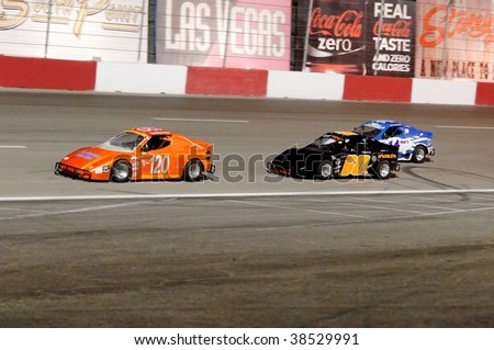 LAS VEGAS - OCT 3: Christian Glass #120 and Patrick O'Hanley #60x stay low while car #14 goes high during the Bandolero race at the Las Vegas Motor Speedway Bullring on October 3, 2009 in Las Vegas. - stock photo