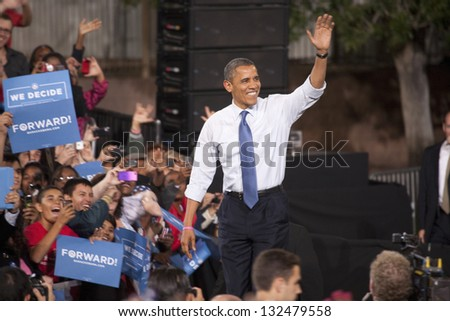 LAS VEGAS - OCTOBER 24: Barack Obama arriving at a campaign rally at Doolittle Park on October 24, 2012 in Las Vegas, Nevada - stock photo