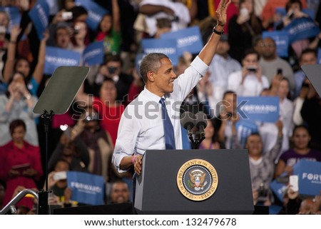 LAS VEGAS - OCTOBER 24: Barack Obama behind the podium at a campaign rally at Doolittle Park on October 24, 2012 in Las Vegas, Nevada - stock photo