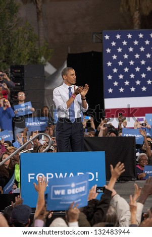 LAS VEGAS - OCTOBER 24: Barack Obama on a campaign rally at Doolittle Park on October 24, 2012 in Las Vegas, Nevada - stock photo