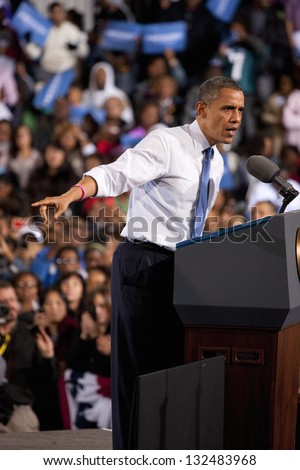 LAS VEGAS - OCTOBER 24: Barack Obama speaking at a campaign rally at Doolittle Park on October 24, 2012 in Las Vegas, Nevada - stock photo