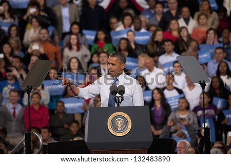 LAS VEGAS - OCTOBER 24: Barack Obama speaks at a campaign rally at Doolittle Park on October 24, 2012 in Las Vegas, Nevada - stock photo