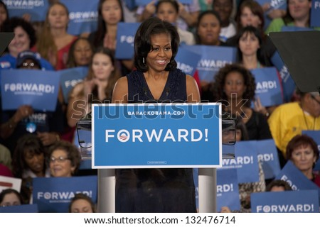 LAS VEGAS - OCTOBER 26: First Lady Michelle Obama speaks at President Obama`s campaign rally on October 26, 2012 at Orr Middle School in Las Vegas, Nevada. - stock photo