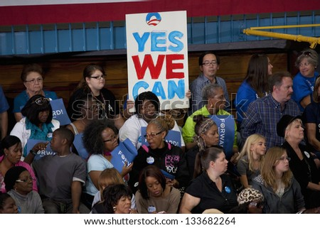 LAS VEGAS - OCTOBER 26: Supporters of Barack Obama at a Presidential Election campaign rally at Orr Middle School on October 26, 2012 in Las Vegas, NV - stock photo