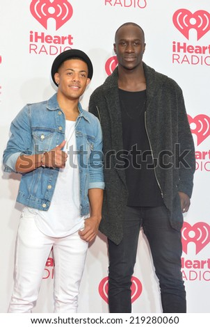 LAS VEGAS - SEP 20 : Musicians Vincent Dery (L) and Nicolas Sereba of Nico & Vinz attends the 2014 iHeartRadio Music Festival at the MGM Grand Garden Arena on September 20, 2014 in Las Vegas. - stock photo