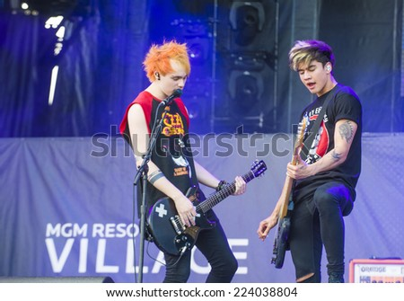 LAS VEGAS - SEP 20: Rock band 5 Seconds of Summer performs on stage at the 2014 iHeartRadio Music Festival Village on September 20, 2014 in Las Vegas.