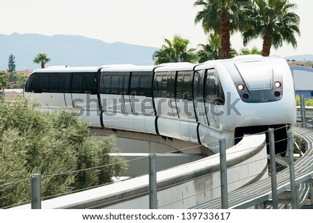 LAS VEGAS - SEPTEMBER 30:Monorail arriving to station on the Las Vegas Strip on September 30, 2011 in Las Vegas, USA. It connects the unincorporated communities of Paradise and Winchester.
