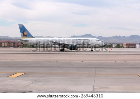 LAS VEGAS, USA - APRIL 15, 2014: Airbus A320 of Frontier Airlines at Las Vegas McCarran International Airport. Frontier carried almost 15 million passengers in 2011.