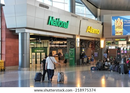 LAS VEGAS, USA - APRIL 13, 2014: Alamo and National car rental airport office in Las Vegas. Both brands are owned by Enterprise Holdings, company employing 74,000 people (2013). - stock photo