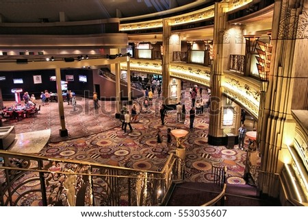 LAS VEGAS, USA - APRIL 13, 2014: People play games at MGM Grand resort in Las Vegas. The casino is owned by MGM Resorts International.