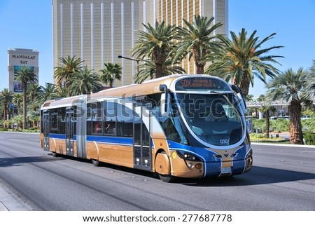 LAS VEGAS, USA - APRIL 14, 2014: People ride SDX bus in Las Vegas. SDX is operated by Wright StreetCar articulated hybrid bus manufactured by Wrightbus and Volvo. - stock photo