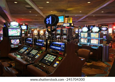LAS VEGAS, USA - APRIL 14, 2014: People visit Treasure Island casino resort in Las Vegas. It is one of 30 largest hotels in the world with 2,884 rooms. - stock photo