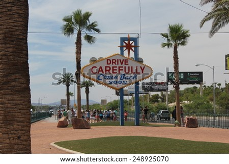 "LAS VEGAS, USA - AUG 5: The backside of the famous Welcome to Las Vegas sign with written ""drive carefully, come back soon"" on August 5 2013, with people around - stock photo"