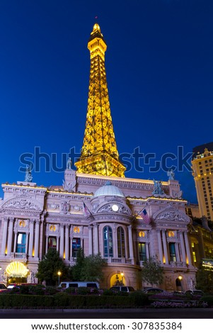 LAS VEGAS, USA - JULY 7 2015: Hotel Paris with half scale, 541-foot (165 m) tall replica of the Eiffel Tower at twilight  in Las Vegas, Nevada. About 40 million people visiting the city each year.