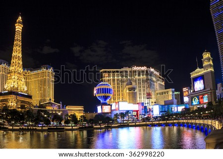 LAS VEGAS, USA - JULY 7 2015: Hotel Paris with half scale, 541-foot (165 m) tall replica of the Eiffel Tower at twilight in Las Vegas, Nevada. About 40 million people visiting the city each year. - stock photo