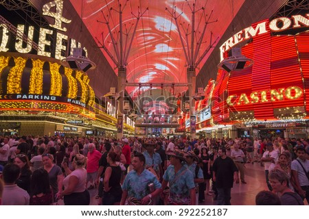 LAS VEGAS, USA - MAY 28, 2015: Huge crowds of tourists gather under the world's largest video screen to enjoy live entertainment, beer, food and casinos at the Fremont Street Experience in Las Vegas