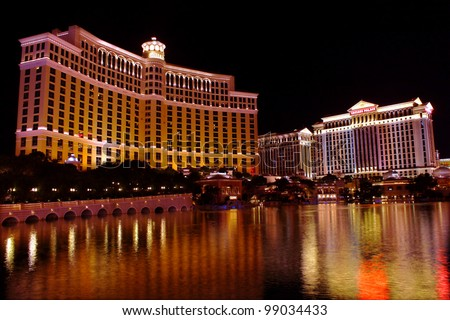 Las Vegas, USA - November 30, 2011:  A large fountain pool is situated in front of the Bellagio Hotel with neighboring Caesars Palace Hotel seen on the right on November 30, 2011 in Las Vegas.