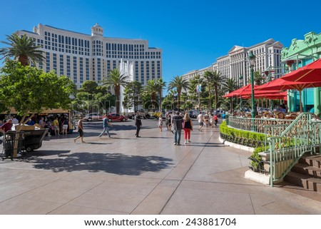 LAS VEGAS, USA - OCTOBER 7: Exteriors of Bellagio (left) and Caesar's Palace (right) on October 7, 2014 in Las Vegas. They are two of the largest hotels in Las Vegas with almost 4000 rooms.  - stock photo