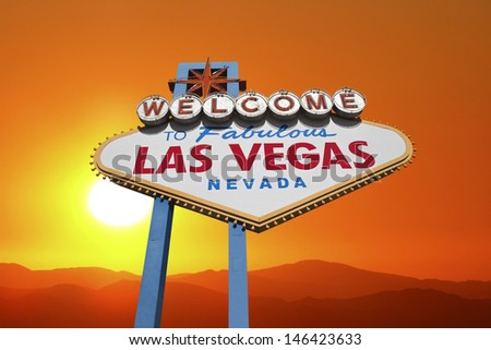 Las Vegas welcome sign with blazing desert sunset.