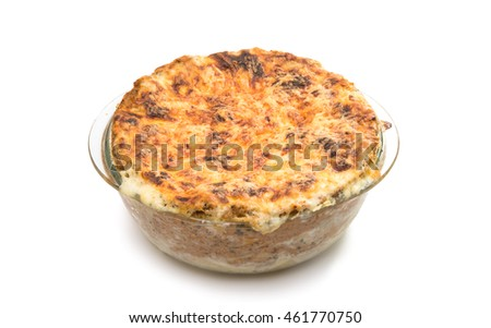 Lasagna in a glass pan on a white background