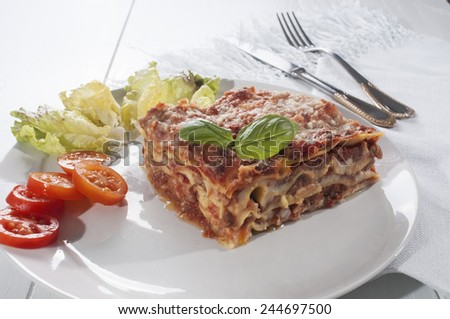 lasagna is a typical Italian meal, made with fresh pasta baked with meat sauce and bechamel sauce - stock photo
